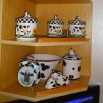 A cabinet of cow-themed crockery