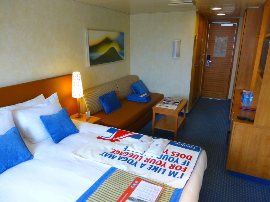 The seating area in cabin 6212 on Carnival Breeze