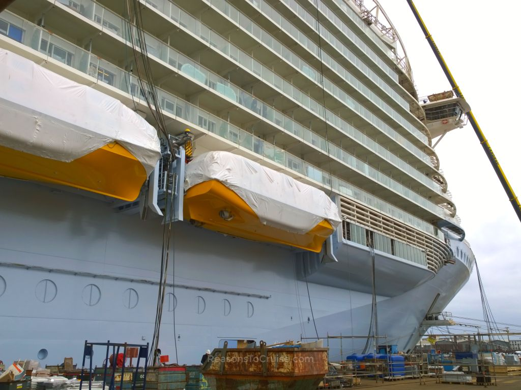 A crane loads equipment onto Harmony of the Seas