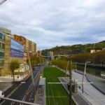 Bilbao's roads, trams, and Deusto canal