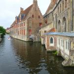 Canal boat tour passes Sint-Janshospitaal
