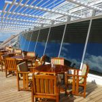 Outdoor seating at the Lido Café on Crystal Symphony