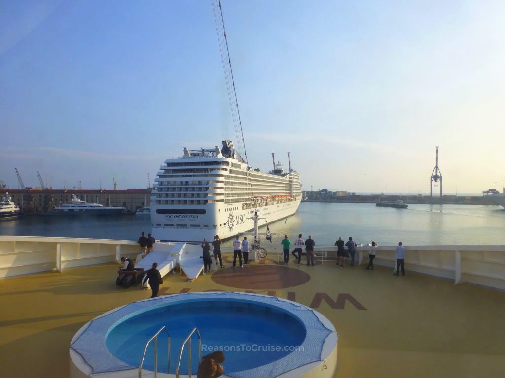 Crew watch a sailaway on MSC Meraviglia